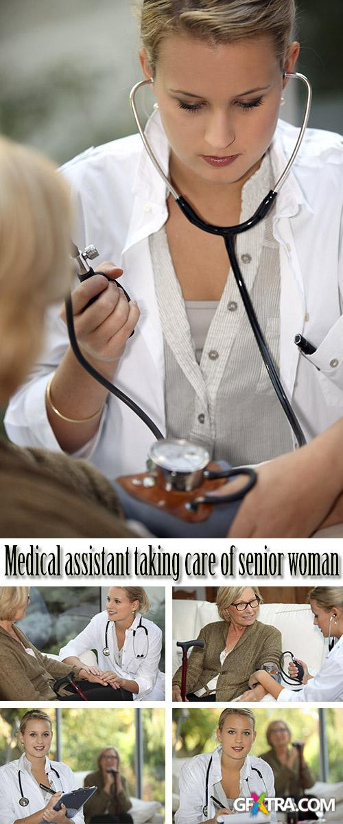 Stock Photo: Medical assistant taking care of senior woman
