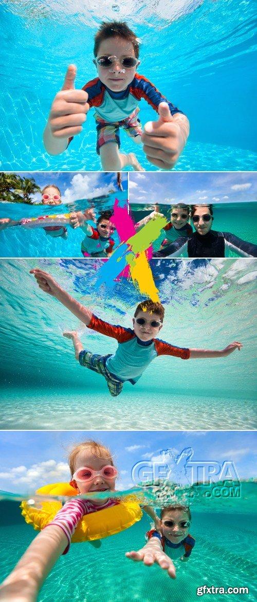 Stock Photo - Kids Swiming Underwater