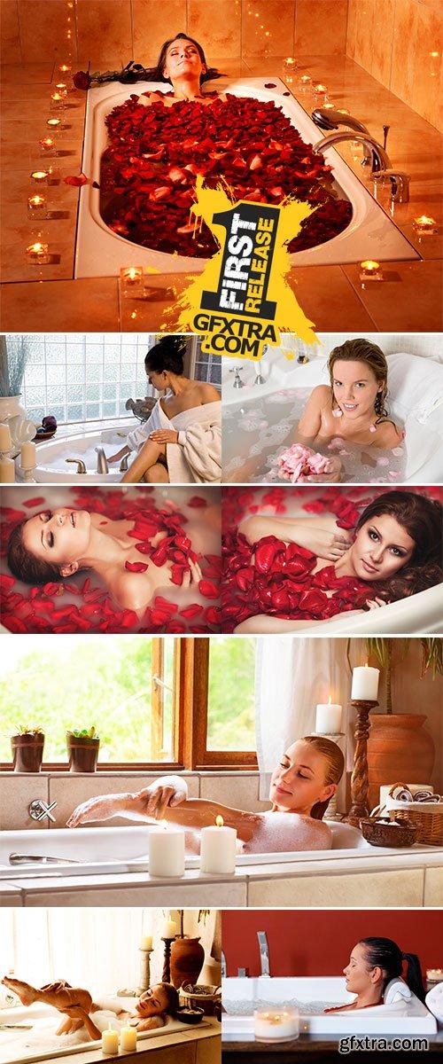 Stock Photo Young woman enjoys the bath-foam in the bathtub