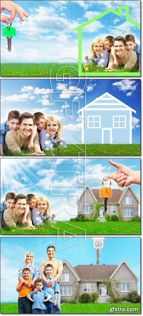 Happy family near new house - Stock photo
