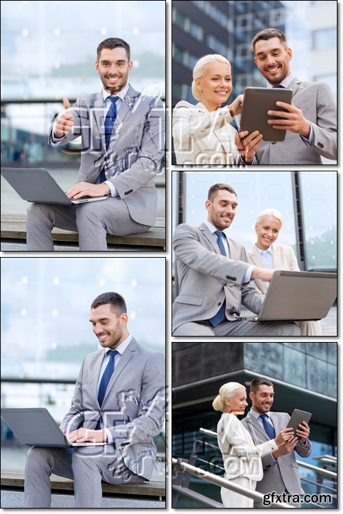 Smiling business people with laptop, tablet pc outdoors - Stock photo