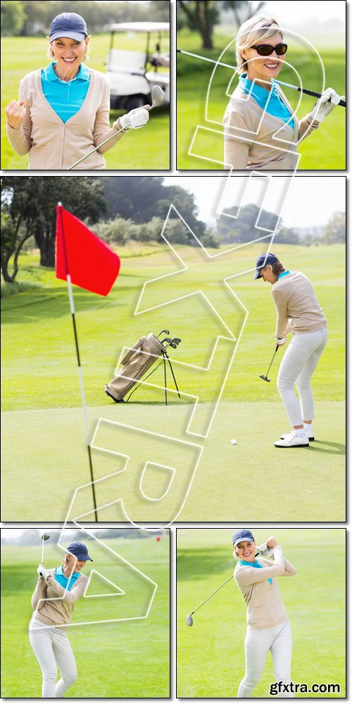 Female, cheerful golfer, taking a shot, smiling at camera - Stock photo