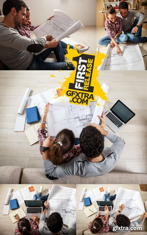 Stock Photos - Young Couple Examing Blueprints of they New House