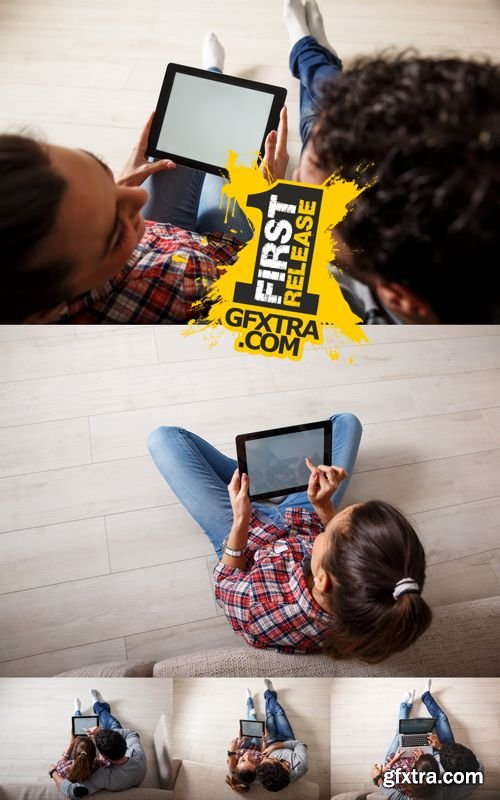 Stock Photos - Young Couple Sitting Using Laptop & Tablet