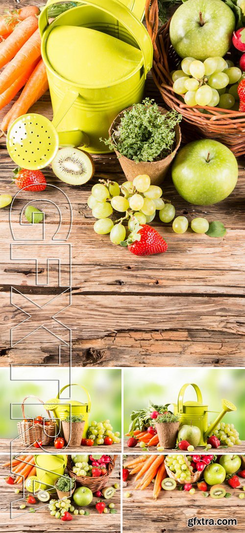 Stock Photos - Garden Concept, Fresh Fruits And Vegetables On Wooden Table, Watering Can, Seeds, Plants