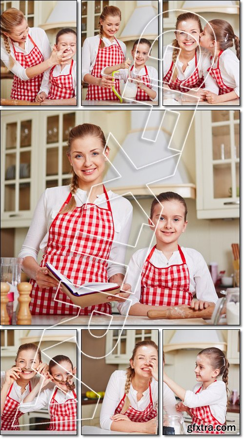 Mom and daughter in the kitchen preparing goodies - Stock photo
