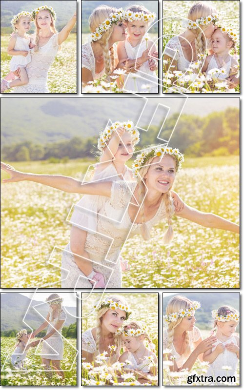 Happy family mother with cute little child girl in the chamomile field in spring - Stock photo