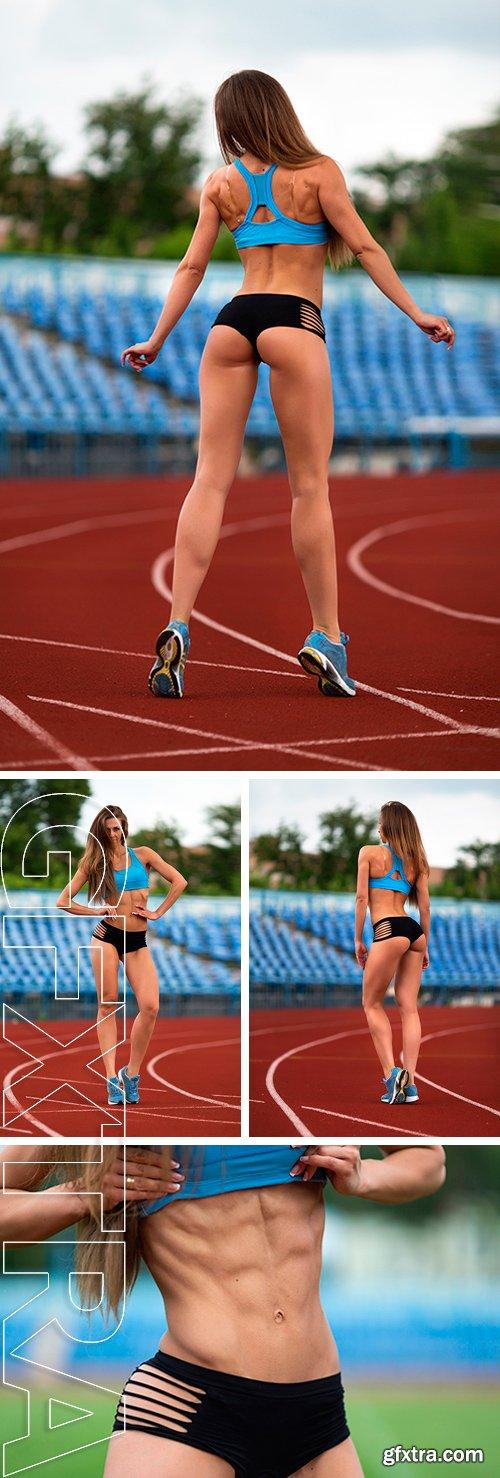 Stock Photos - Sexy fitness.Female model posing at the stadium