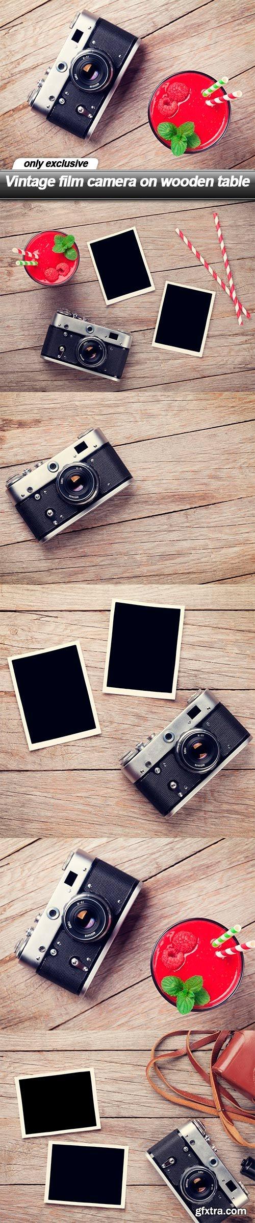 Vintage film camera on wooden table - 5 UHQ JPEG