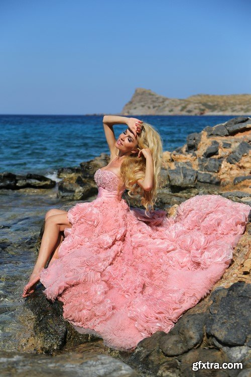 The blonde in a pink dress on the island