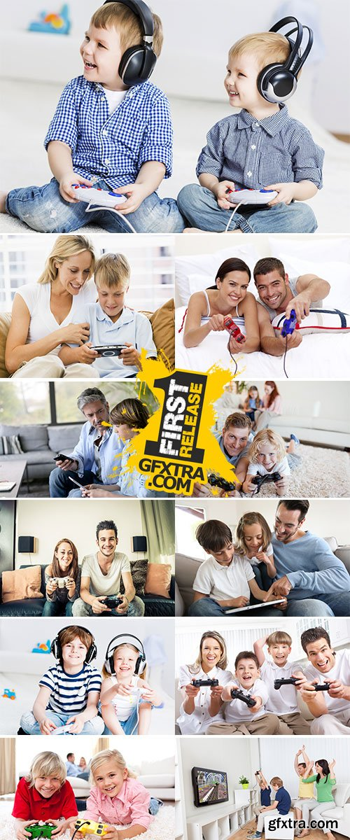 Stock Images Young family having fun playing videogames at home