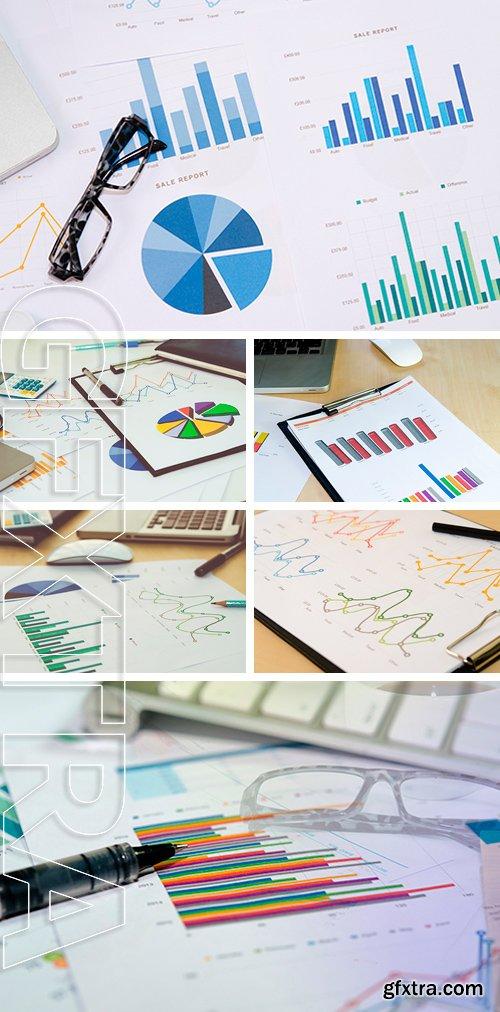 Stock Photos - Financial graphs analysis and pen