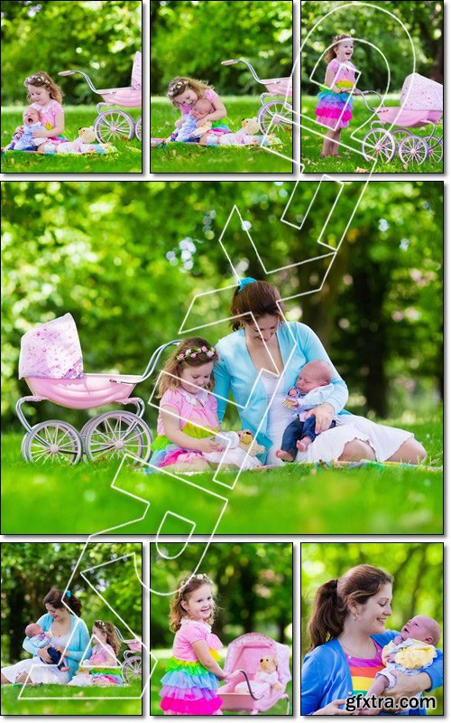 Family with children enjoying picnic outdoors. Little girl playing with newborn baby brother in summer park - Stock photo