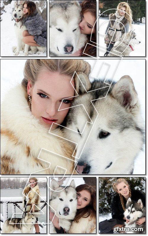 Young woman with wolf dog in snow - Stock photo