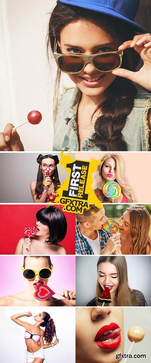 Stock Image Woman sucking lollipop
