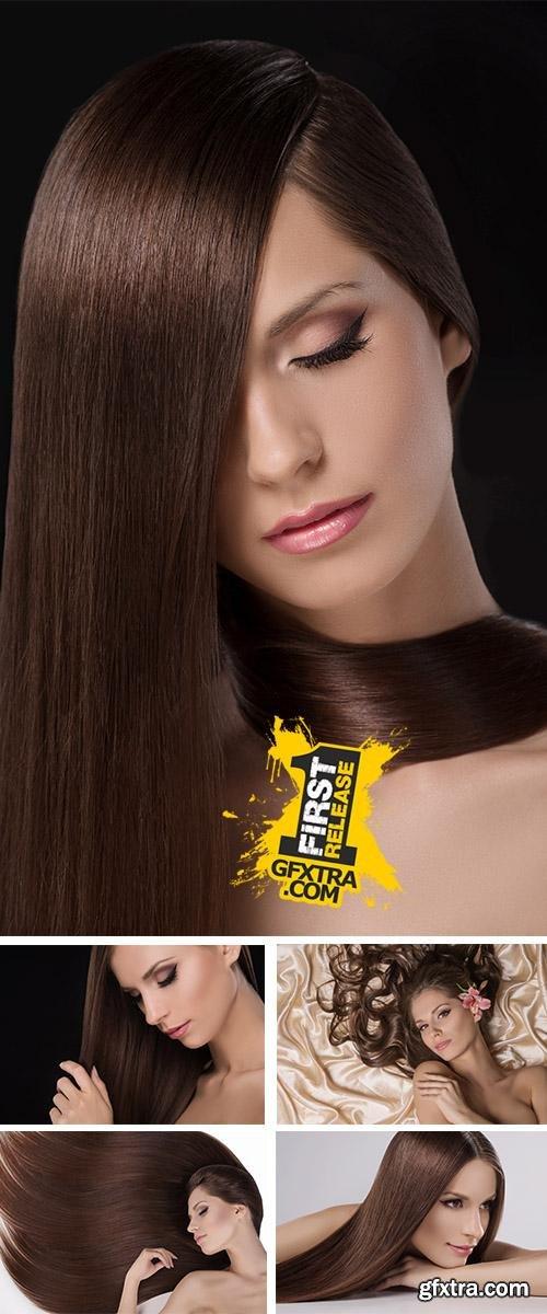Stock Photo: Beautiful women touching hair