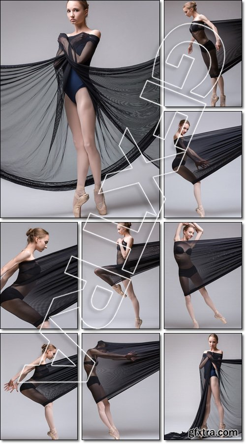 Slim dancer plays with black mesh fabric in the studio - Stock photo