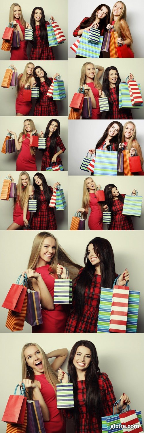 Two young women wearing red dress with shopping bags