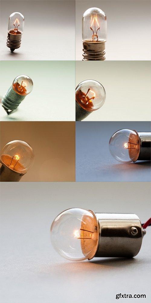 Glowing light bulb, Retro style filament lamp macro view