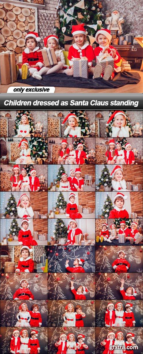 Children dressed as Santa Claus standing - 28 UHQ JPEG