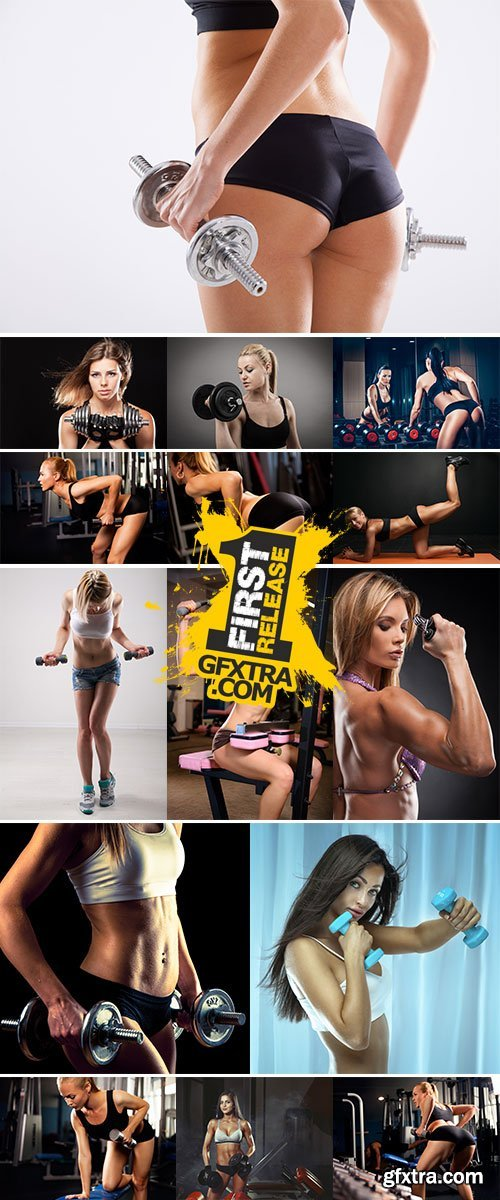 Athletic young lady doing workout with weights - Stock Image