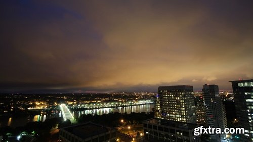 Sunrise breaking over city time lapse