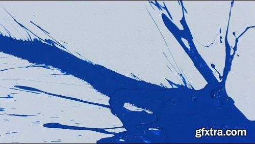 Slow motion blue on white paint splatter