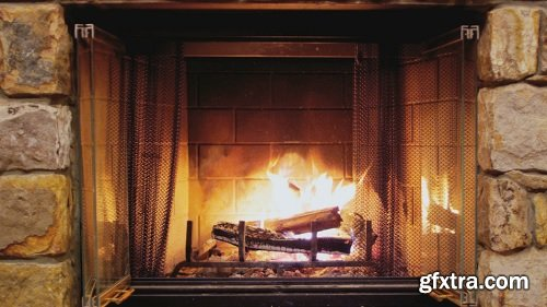 Rack focus to burning fireplace