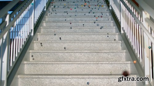 Slow motion bouncy balls on marble steps