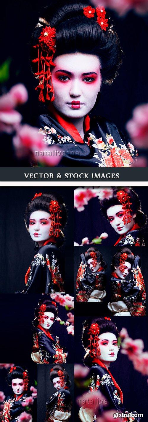 Geisha east beautiful girl in Oriental cherry branches