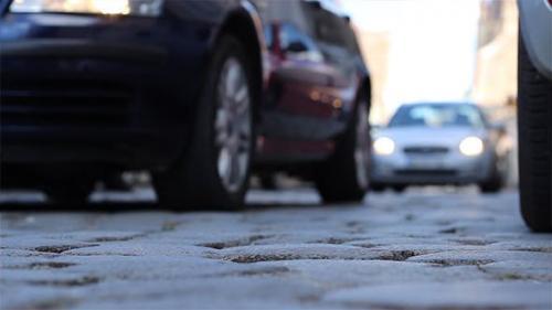 Udemy - Ground View Cobblestone Street Cars