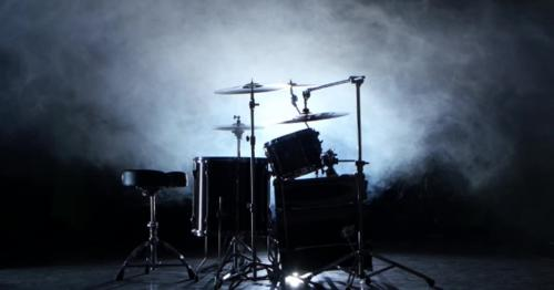 Set of Drums, Cymbals and Other Percussion Instruments. Black Smoky Background. Back Light. - NMJV2UH