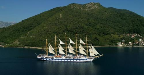 Aerial View of a Large Yacht That Swims in the Kotor Bay - N4UL8G3