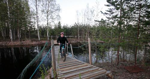 Bicyclist Rides Over The Bridge - EUNTS4H