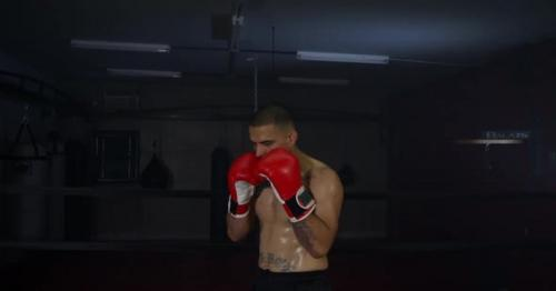 Boxer Punching In Boxing Ring 30 - C7K6A9E