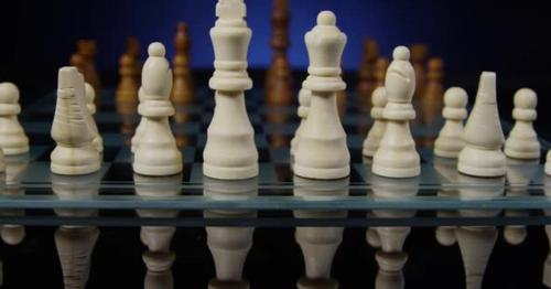Chess Pieces on a Glass Chess Board 34 - NXRD6VE