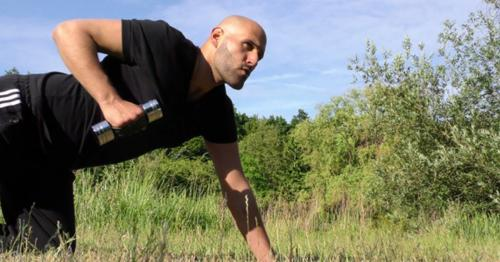 Man Training in Nature On Grass - DFNGWB7