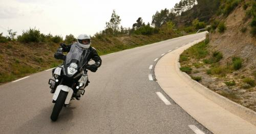 Motorcyclist Driving his Sports Motorbike on a Curvy Road - E98A6UV