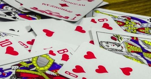 Playing Cards Moving And Rotate On a Wooden Table - 8E35UQW
