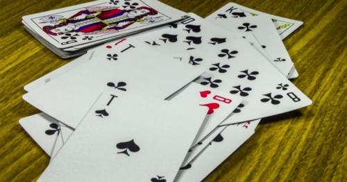 Playing Cards Moving And Rotate On a Wooden Table - GUR7MNW