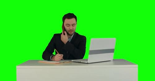 Young Business Man Speaking on the Phone in Office. on a Green Screen - YGNML8W