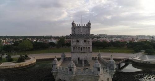 Belém Tower with Lisbon in the Background - 89E73D6