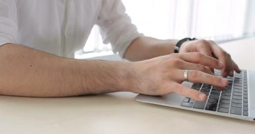 Man Typing On The Keyboard In The Office - 2MUJSFD