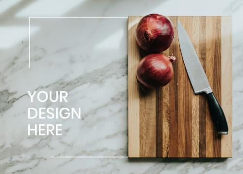 Frame mockup with an onion on a cutting board - 1211415