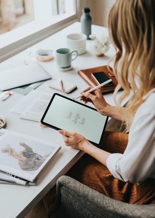 Fashion designer working on a digital tablet mockup - 1211512