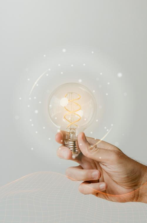 Hand holding a light bulb mockup - 1213950