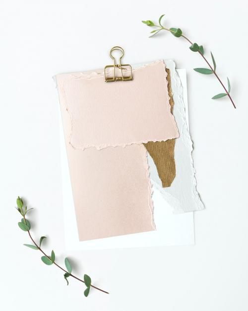 Blank torn pink paper templates set with a paperclip - 1201835