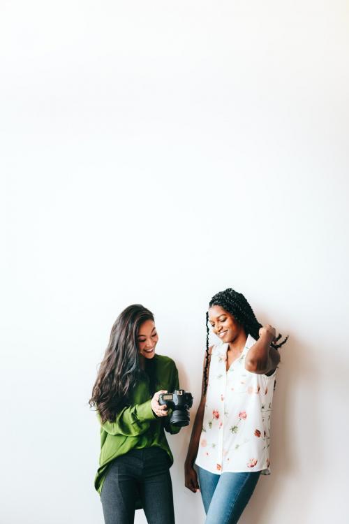 Happy women with a digital camera talking - 1226480