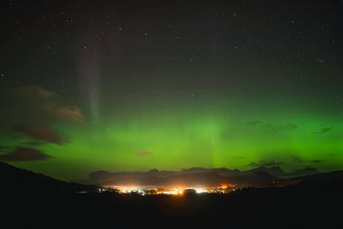 Aurora borealis over the Isle of Skye in Scotland - 1233438