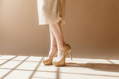 Fashionable woman wearing creamy heels - 1235464